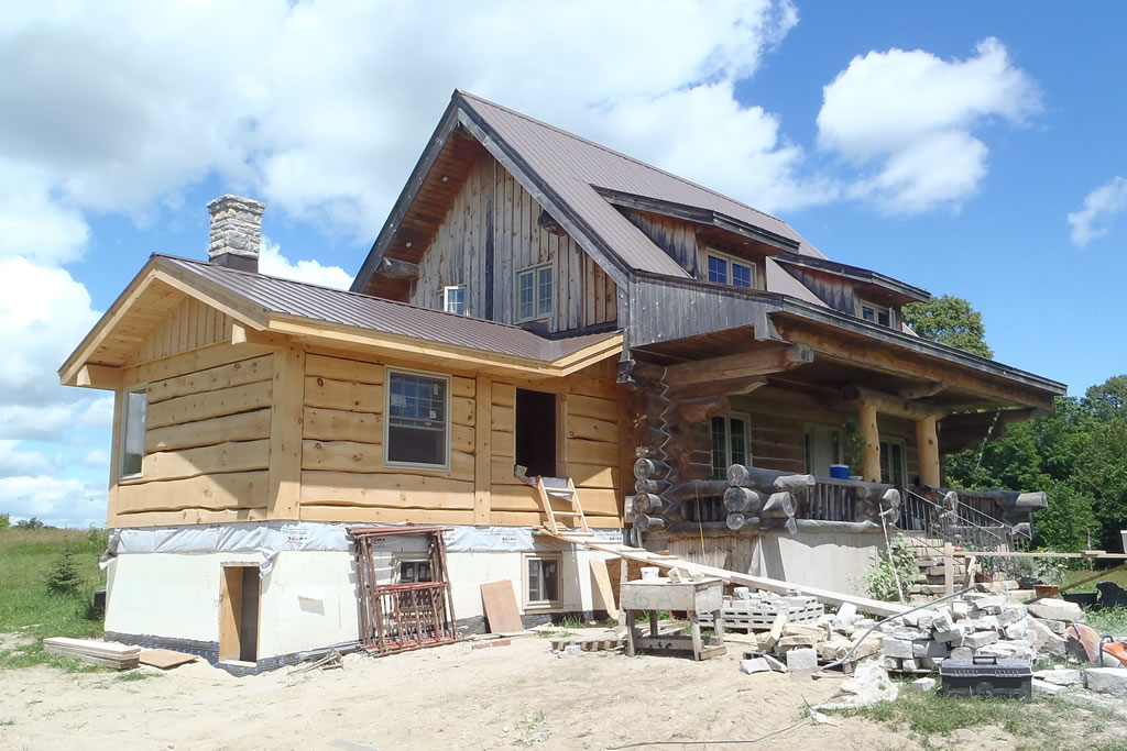 Riversong design renovations timberframe sustainable for Log home addition